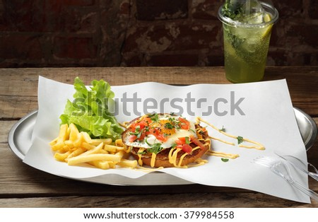 The dish with food on background fresh mojito cocktail - stock photo