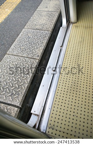 The distance gap between the train and platform - stock photo