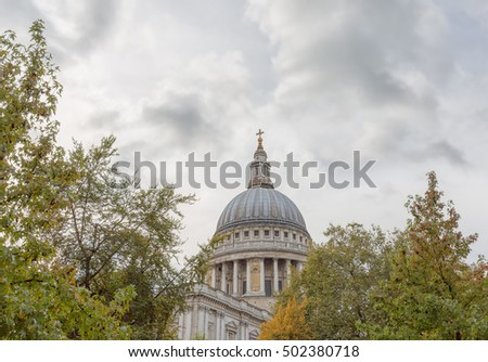 The distinctive dome of London's St Paul's Cathedral photographed through trees.