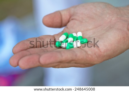 the doctor gave the patient medication capsules  - stock photo
