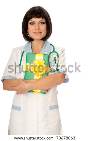 The doctor holding a gift from patient in the hand - stock photo