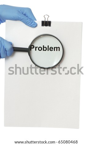 The doctor in blue gloves holds a list of problems in the hands