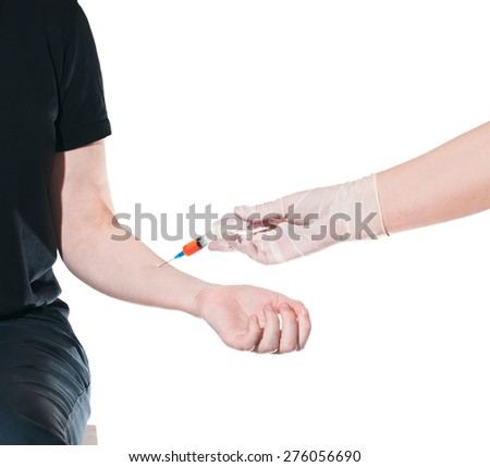 The doctor makes the patient an injection into a vein. Isolated on white background - stock photo