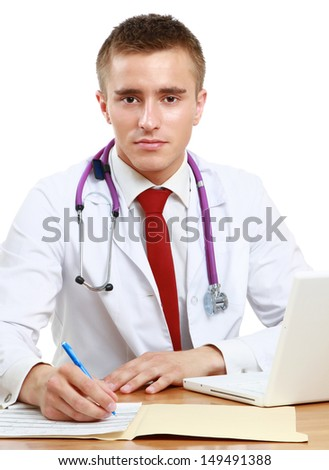 The doctor writing on the desk, isolated on white background - stock photo