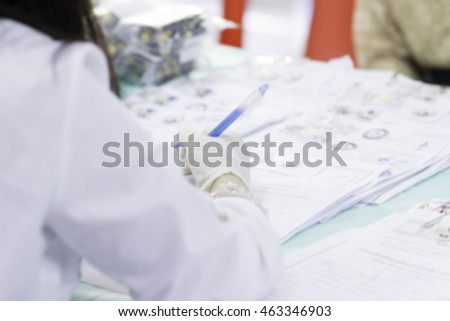 The Doctor writing Report at patient in hospital.