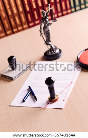 The document waiting for the signature of a notary. Notary work tools on the desk - stock photo