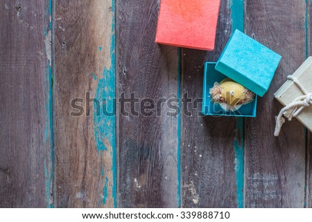 The doll in a gift box  on the background. - stock photo