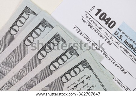The dollar banknotes with tax form for business and finance concept