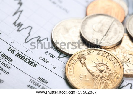 the dollar coin and financial graph - stock photo