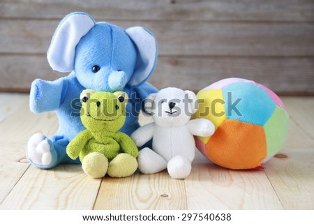 The dolls on wooden table - stock photo