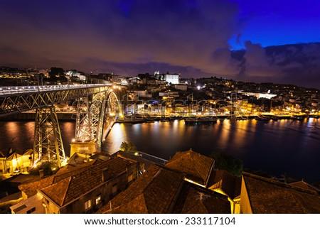 The Dom Luis I Bridge is a metal arch bridge that spans the Douro River between the cities of Porto and Vila Nova de Gaia, Portugal - stock photo