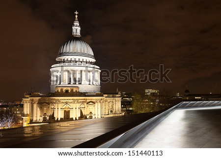 The dome of St Paul's Cathedral lit up at night.