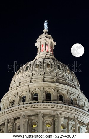 The dome of Texas Capitol on a full moon night in Austin.