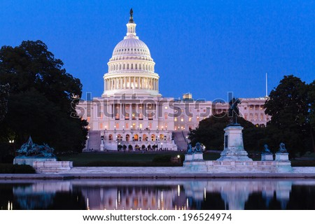 The dome of the Capitol, seen from the the Capitol Reflecting Pool, Washington DC, USA. - stock photo