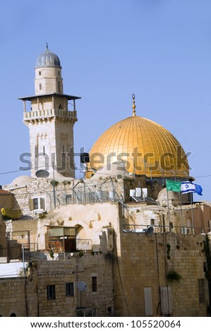 The Dome of The Rock and  Ghawanima Minaret from The Western Wall with Israeli flag Jerusalem Palestine Israel - stock photo