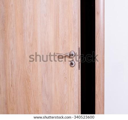 The door ajar - closeup shot & Door Ajar Closeup Shot Stock Photo (Royalty Free) 340523600 ...