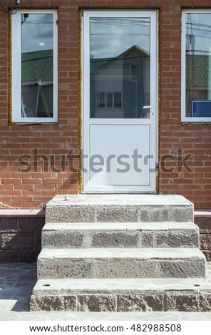 The door in a brick wall of the house