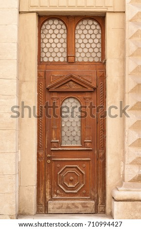 The door of the old European building. Exterior design element of ancient Lvov. Example of world architectural heritage.