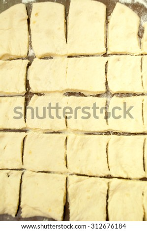 The dough that is cut up to prepare dumplings. - stock photo