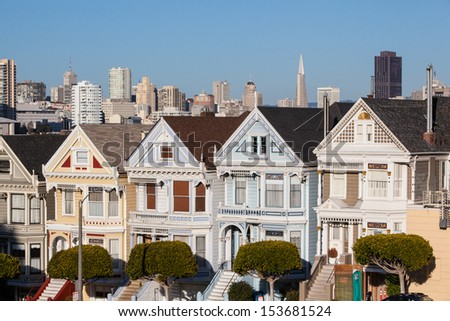 The Downtown area of San Francisco from Alamo Square Park at sunset. In California, USA - stock photo