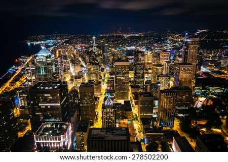 The downtown skyline at night, in Seattle, Washington. - stock photo
