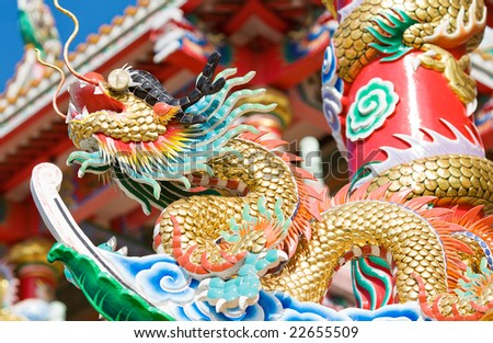 The dragon on the temple roof cholburi Thailand - stock photo
