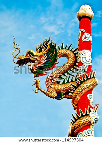 The Dragon status on pole in joss house - stock photo