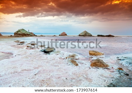 The dramatic and mysterious scene in Salt Lake, sunset with upcoming storm and incredible sky! Excellent atmosphere! Shallow depth of field. - stock photo