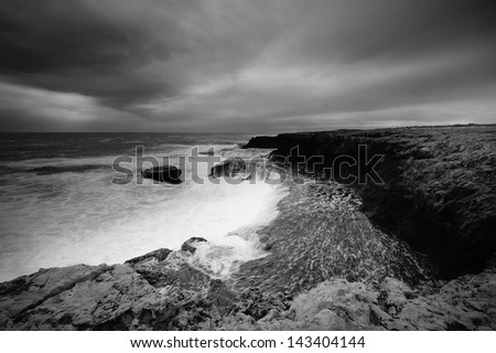 The dramatic and wild black and white rendition of Western Australian coast line. - stock photo