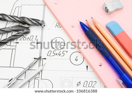 The drawing, compasses, drills and a stationery. - stock photo