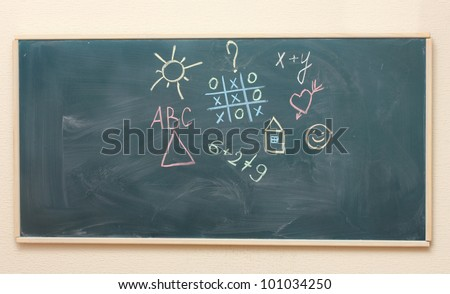 The drawings and inscriptions in colorful chalk on the blackboard - stock photo