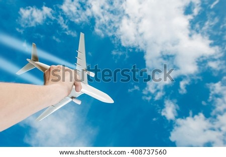 The Dream of Flight. Air Travel Idea Photo Concept with Airliner Airplane Model in a Hand. Business Flights. - stock photo