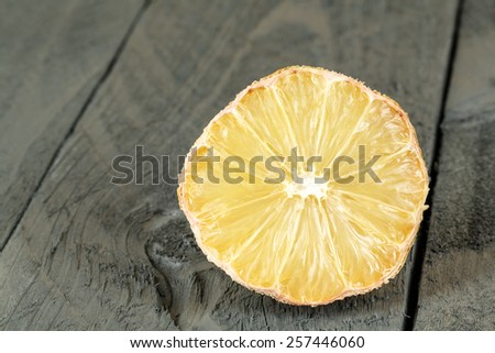 The Dried lemon shown on wooden background - stock photo