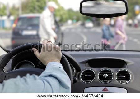 The driver and a pedestrian at a crosswalk - stock photo