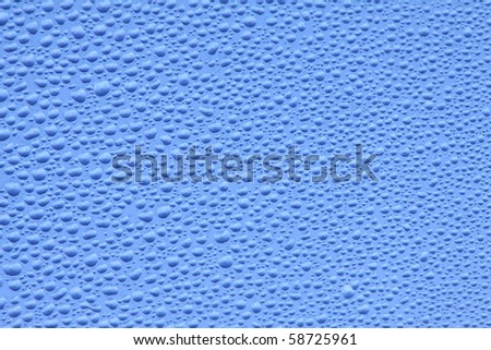The drops which have frozen on glass of water of the different size. - stock photo