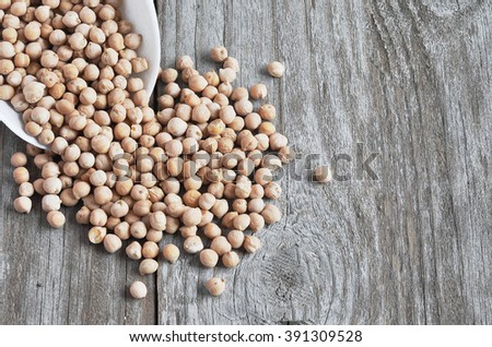 The dry chickpeas un the wood bacgraund. Cicer arietinum.  Legume of the family Fabaceae. Egyptian pea. - stock photo