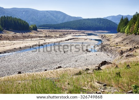 The dry lakebed of Lake Detroit behind the Detroit Dam in the Oregon Cascades is an indicator of the drought conditions in the American West in 2015. - stock photo
