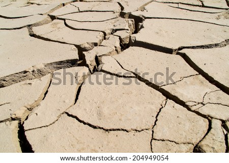 The dry soil in the hot California sun. - stock photo