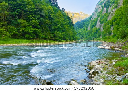 The Dunajec River Gorge. National border between Poland and Slovakia. The Pieniny Mountains Range nature reserve. - stock photo