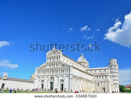 The duomo (cathedral) on the Piazza di Miraculo, with the leaning tower in the background at Pisa, Italy - stock photo