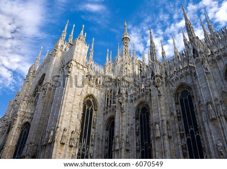 The Duomo, Milan's cathedral, is one of the largest churches in the world; is a surprisingly elegant mass of marble boasting 135 spires and 3,400 statues. - stock photo