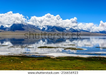 the Duoqing lake with the snowy peak of the holy mountain Chomolhari in Tibet, China.