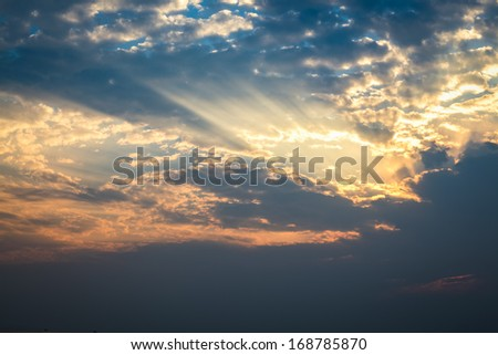 the dusk sky background,rays of the sun light clouds in sunset  - stock photo