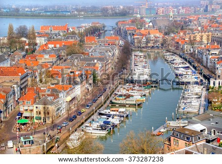 the Dutch village of Dordrecht seen form above, Dordrecht is the oldest ciy in het Netherlands and lays against the mas river and has beautiful canals - stock photo