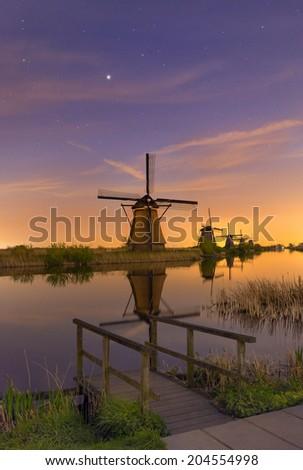 The dutch windmills at Kinderdijk, an UNESCO world heritage site. - stock photo