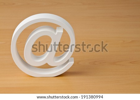the e-mail logo in white on a wooden plate - stock photo