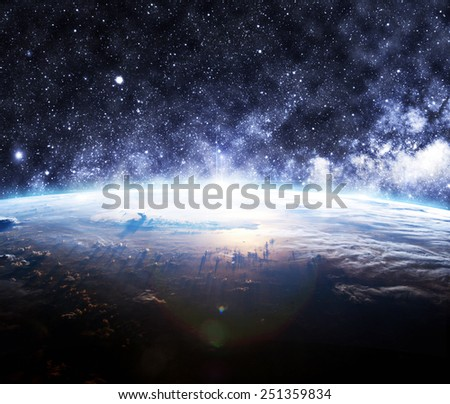 The Earth Below a Starry Sky - Elements of this Image Furnished by NASA - stock photo