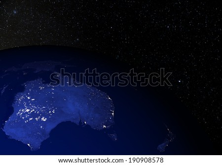The Earth from space at night, with stars in the background. Australia. Elements of this image furnished by NASA. Other orientations available.  - stock photo