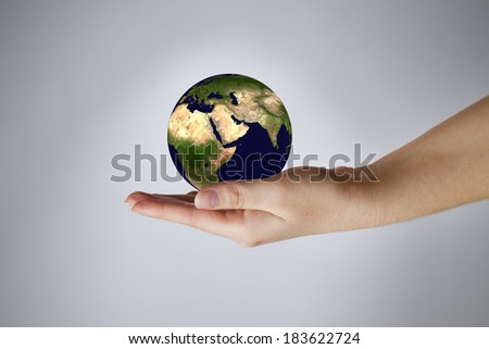The Earth in a female hand. Gray background. 3D render. Elements of this image furnished by NASA - stock photo