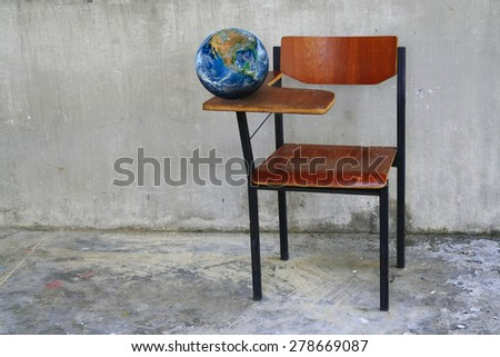 the earth on class room desk ,including elements furnished by NASA
